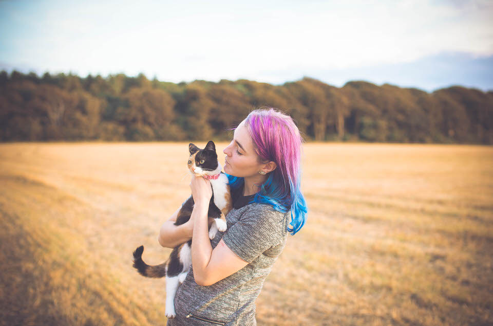 Liverpool Wedding Photographer holding a cat in a field