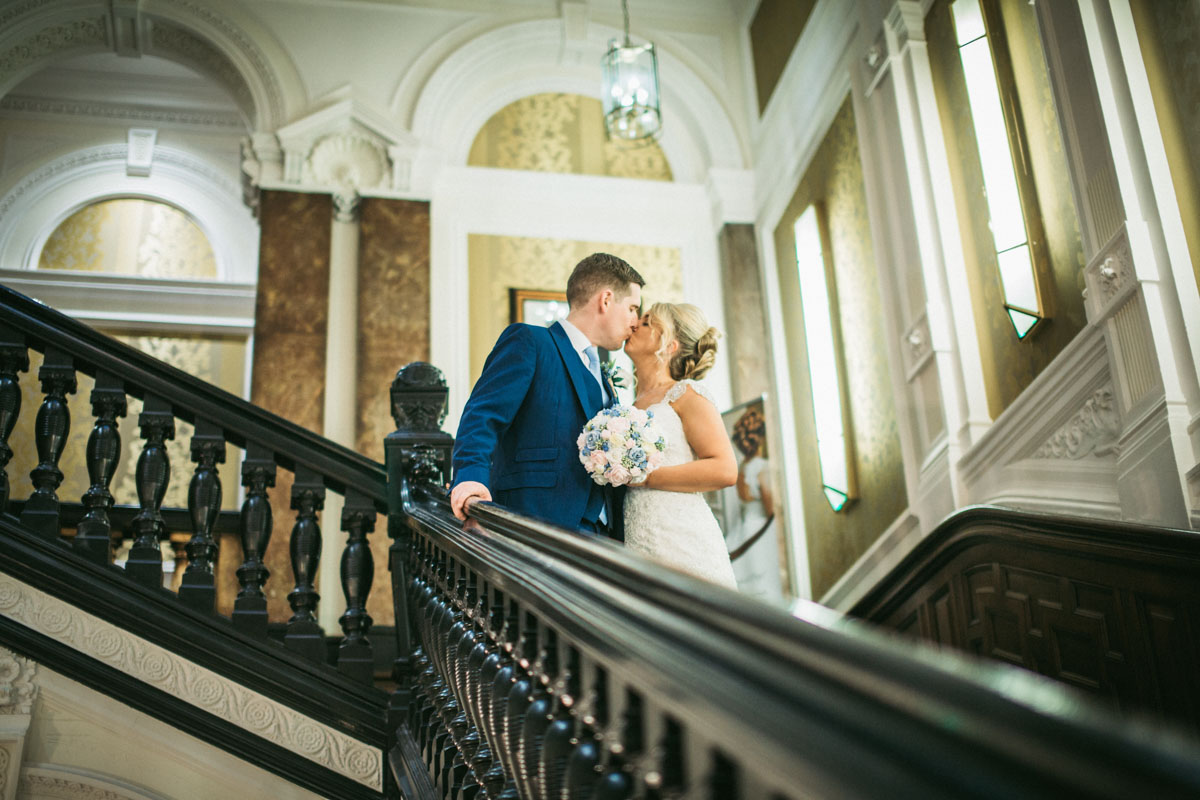 kissing on the staircase at Double Tree Hilton Liverpool