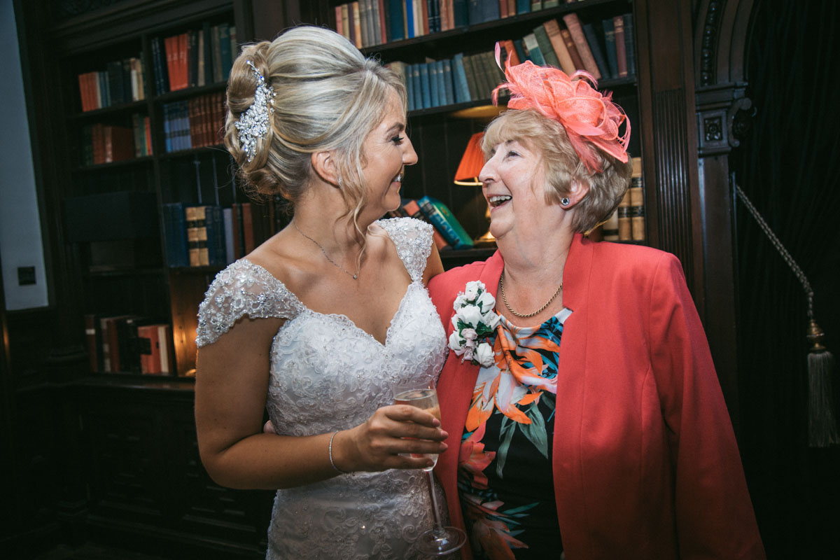bride and her mum laughing