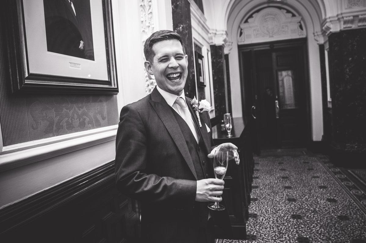 laughing groom