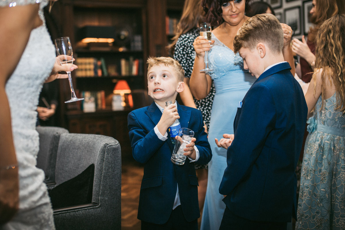child pulls scared face after spilling a drink