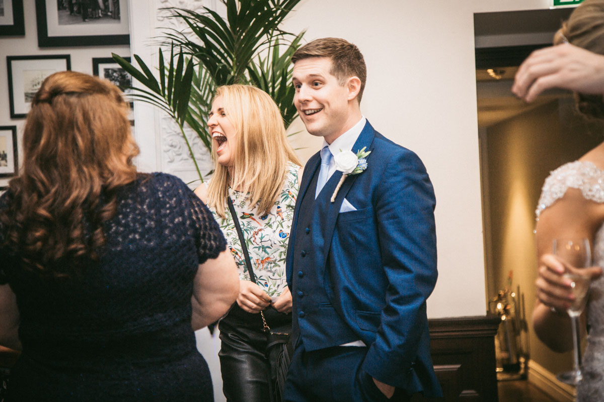 shocked groom and laughing guests