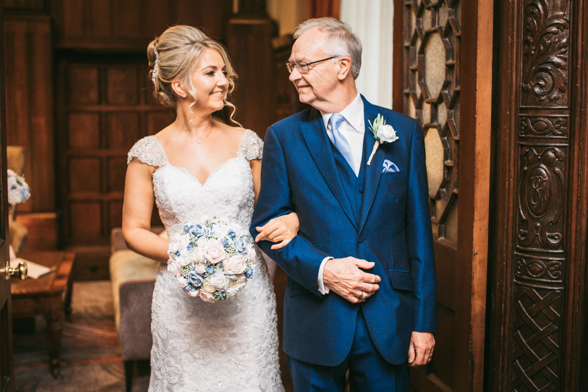 bride smiling at her dad