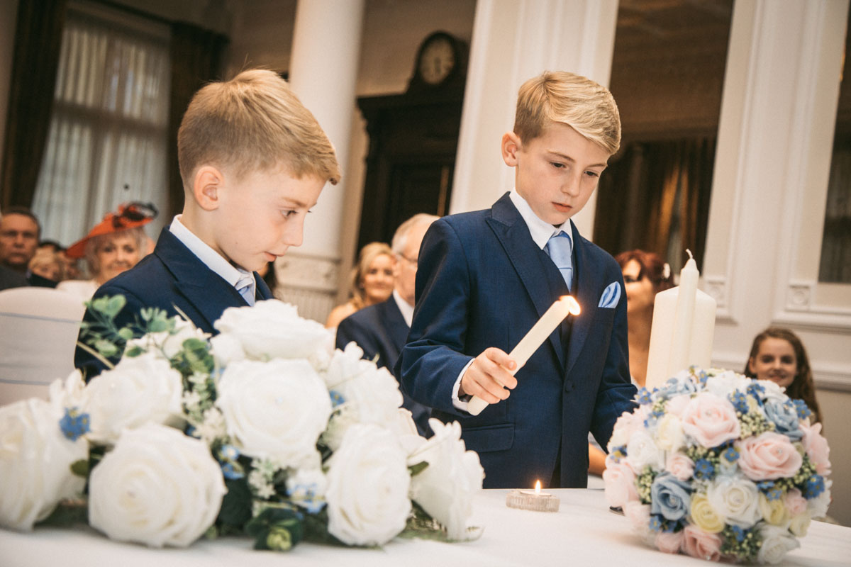 sons lighting candles
