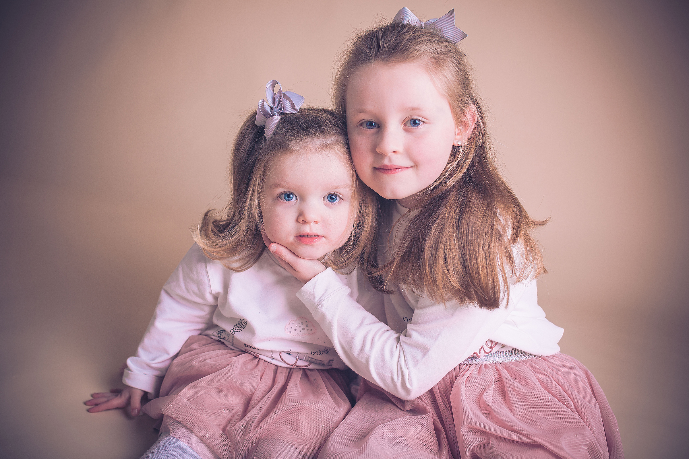 two sisters photoshoot in liverpool studio seaforth family photographer