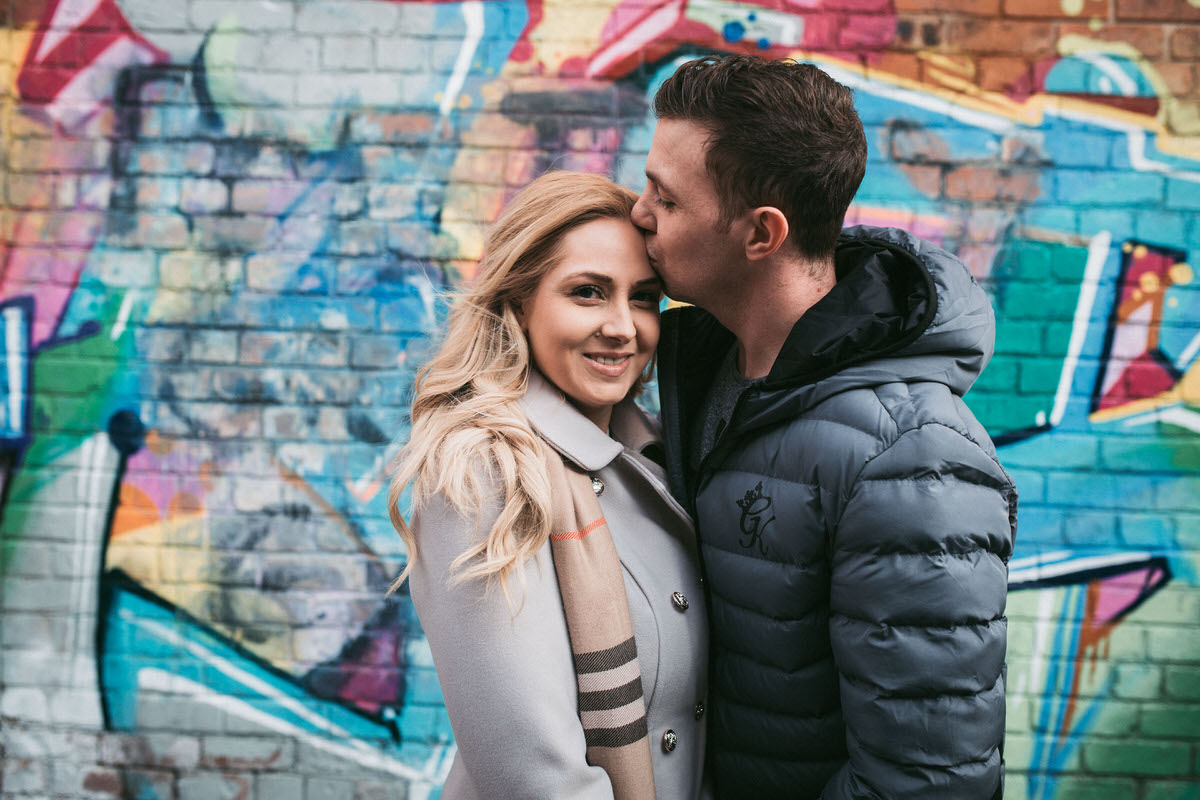 gorgeous couple in front of graffiti at their Pre Wedding Shoot at the baltic Triangle in liverpool