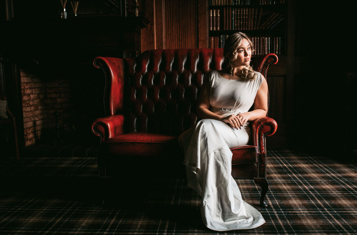 bride relaxing on a sofa at ashfield house