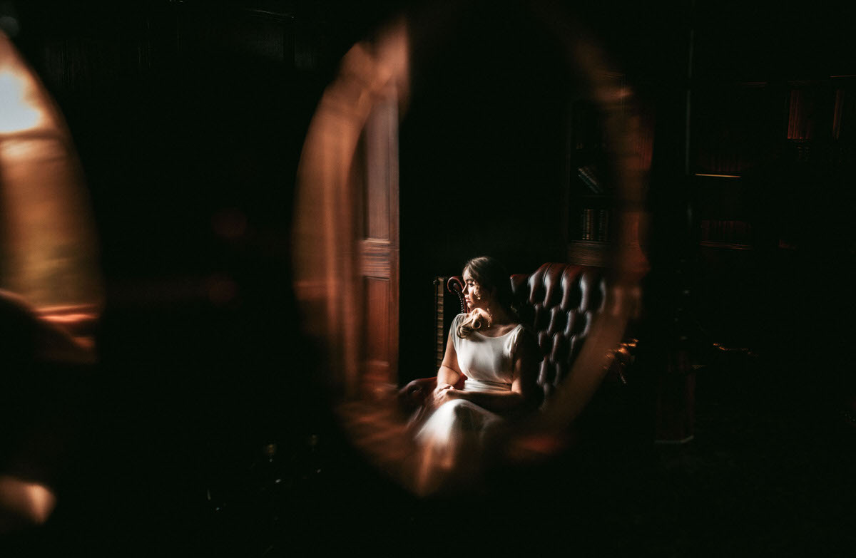 bride's reflection in bar taken by liverpool wedding photographer at ashfield house