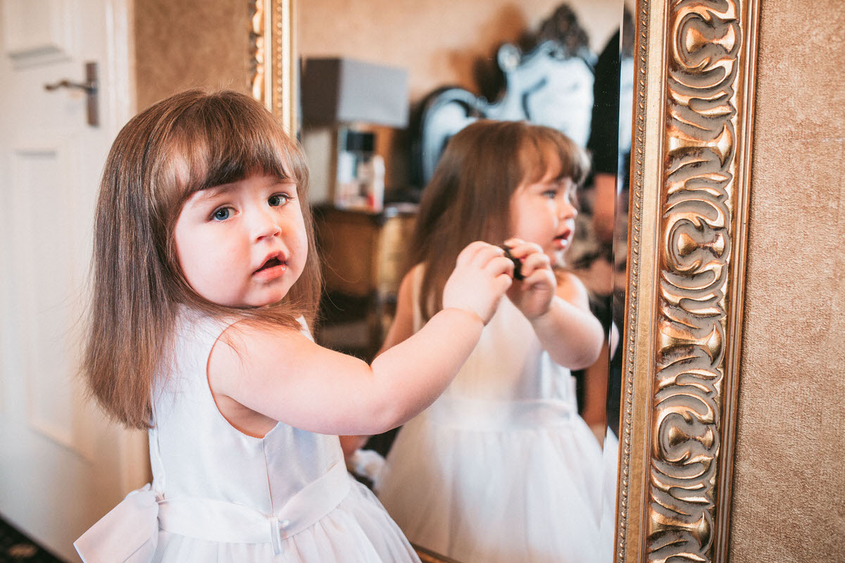 baby girl looking in Mirror