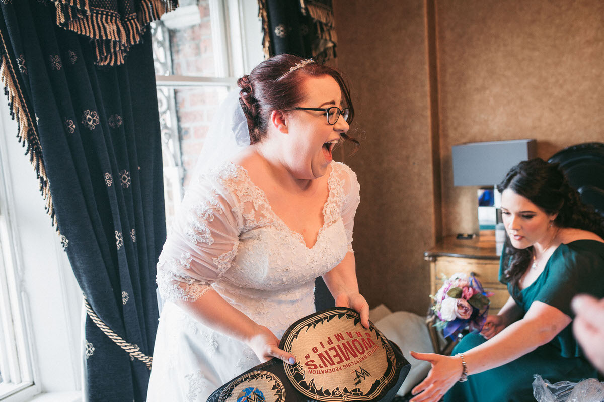 the bride opens a surprising and funny gift from her soon to be husband