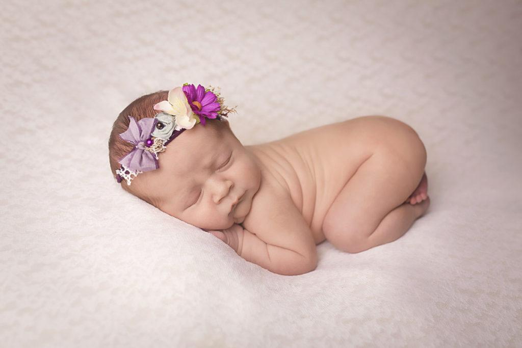 newborn baby in bum up pose taken in liverpool studio