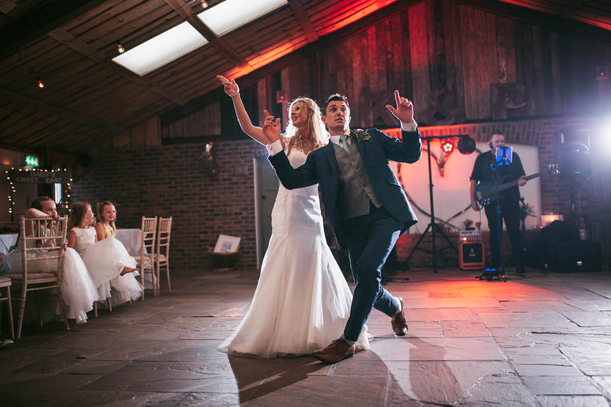 the bride and groom do a cool dance to let's get ready to rumble