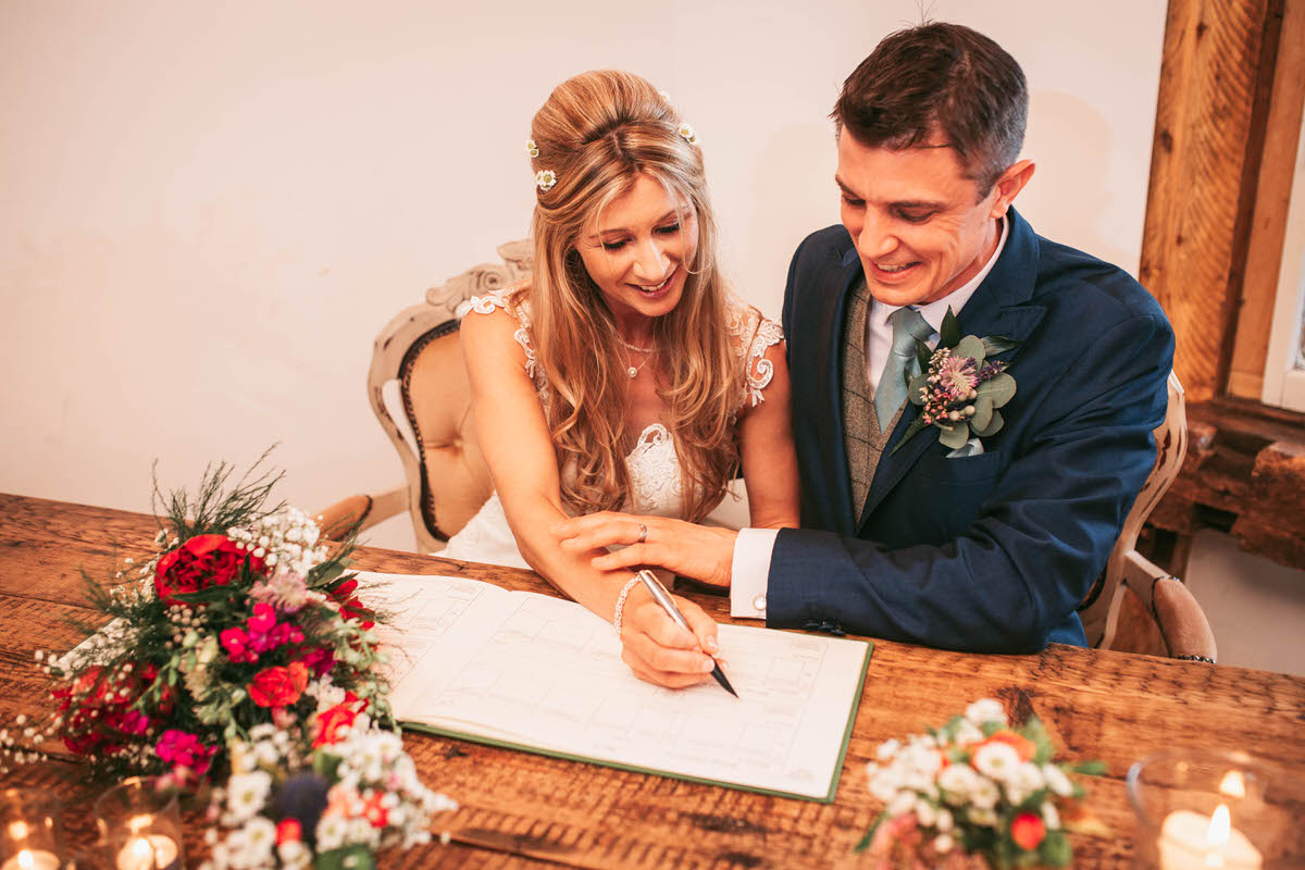 signing the register at owen house wedding barn by liverpool photographer