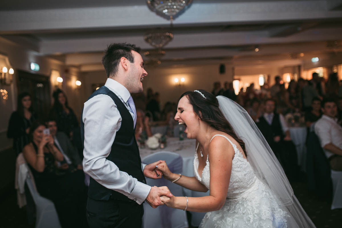 Happy couple rock out to feeling good for their first dance at willington hall cheshire