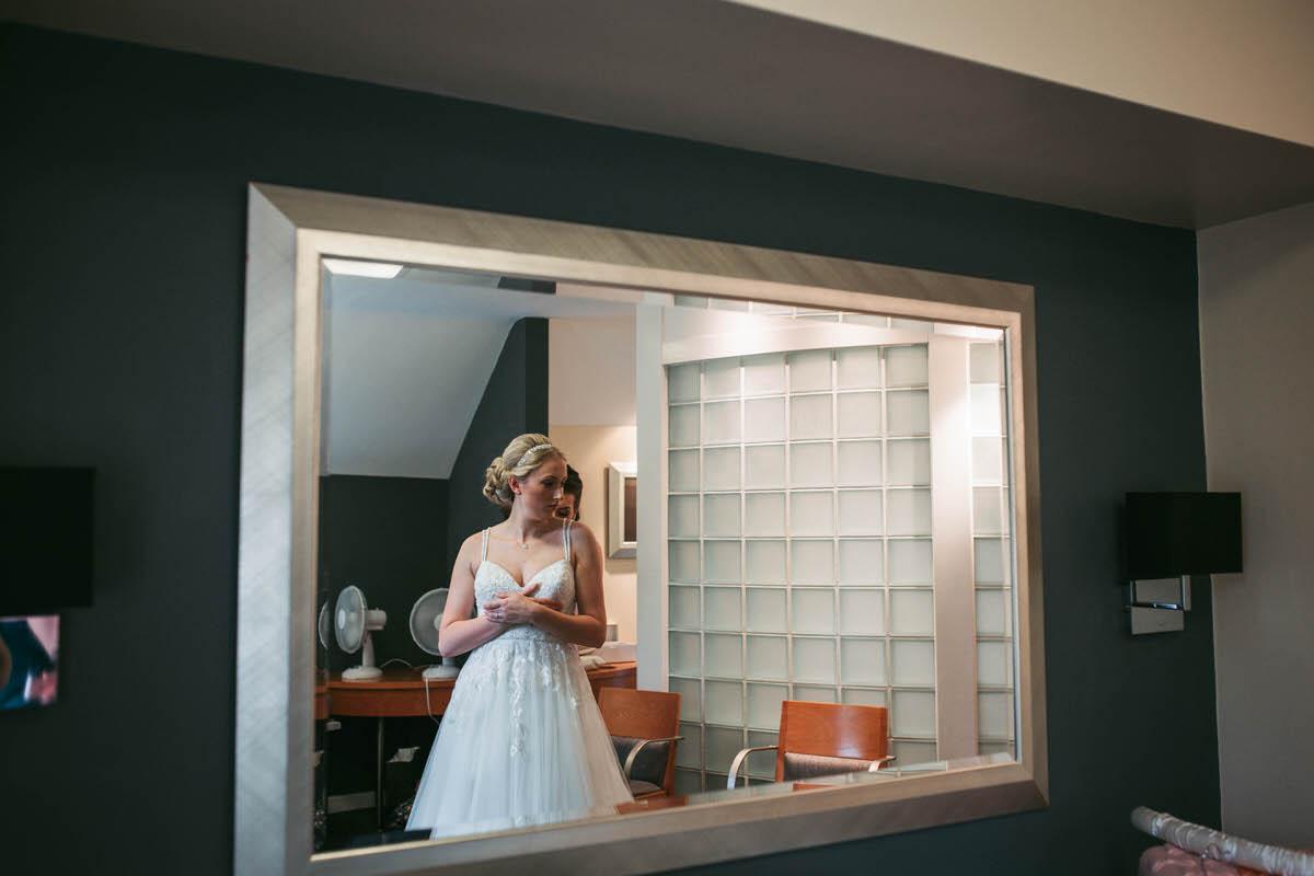 bride gets her dress put on wild pheasant hotel llangollen